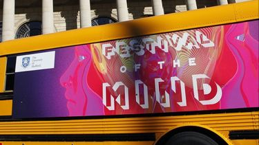 Banner on the side of the festival of the mind bus, parked outside city hall