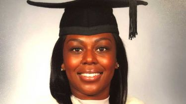 A photo of Jade Powell-Thomas at their graduation - image