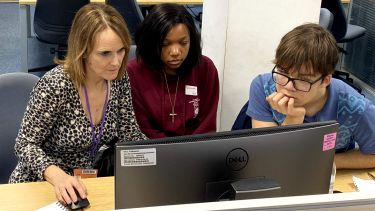 Katie Stewart of the Department of Journalism Studies in a newsroom with two local school pupils at our taster day