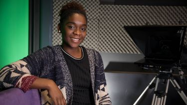 A photo of Paula Ugochukwu in a recording studio - image