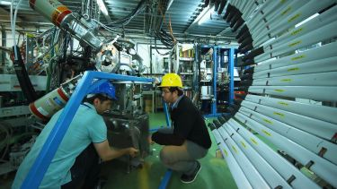 People working behind the scenes at the large hadron collider at CERN