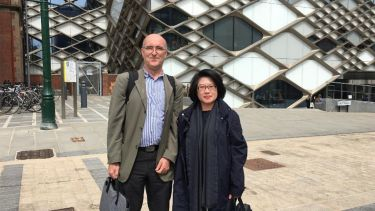 Academics Lenny Koh and Paul Sharrat stood in front of The Diamond building