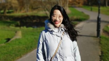 Photo of student Liz Qiao standing outside
