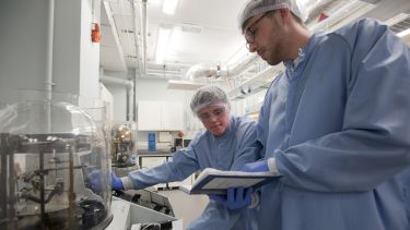 Researchers working in a materials laboratory