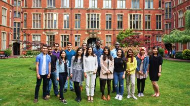 A group of International student ambassadors stand together in Firth Court