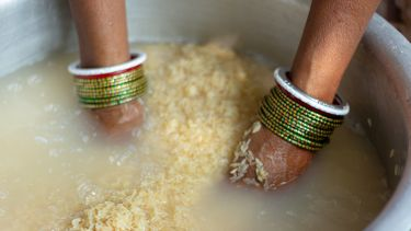 Close-Up Of Woman Preparing Food - stock photo taken in Delhi, India