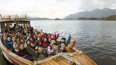 Students on a boat during Lake District trip