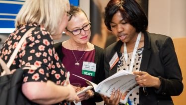 Susan Fitzmaurice and Nicola Talbot talk to a guest at City Connections event