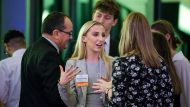 A Sheffield alum converses with students at a City Connections event