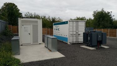 Installation of flywheels in shipping containers at the Willenhall site.
