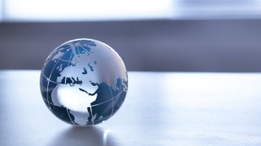 A transparent globe on a table