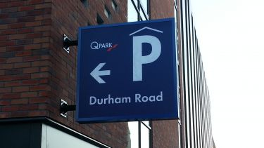 A sign indicating the direction of QPark on Durham Road