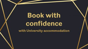 Book with confidence text on black and gold background