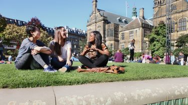 Students sitting in Peace Gardens