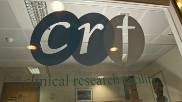 CRF Clinical research glass logo