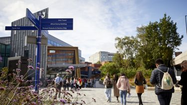 People walking on the concourse in the heart of the University of Sheffield's campus, near its Students' Union building