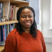 A profile photograph of Dr Bina Ogbebor.