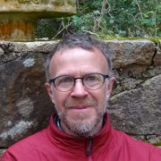 Photo of Dr Steve Connelly against stone wall