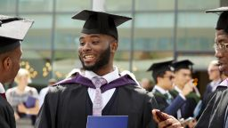 A close up of a student on his graduation day