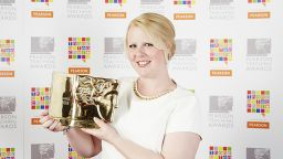 PGDE award winner Lorna holds her trophy - image