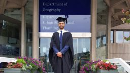 Graduate Aamir Khan standing outside the Geography Dept