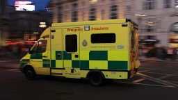 "An ambulance speeds through London's Piccadilly Circus. ""Day 2 - England 52"" by Mike Miley is licensed under CC BY-SA 2.0"