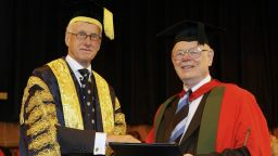 Former University Chancellor Sir Peter Middleton, presenting Dr Alan Kelly with his honorary degree