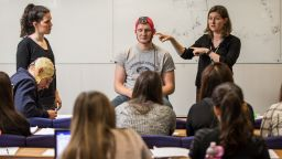 Professor Elizabeth Milne demonstrates electroencephalography in an undergraduate psychology class.