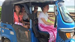 students sat smiling in a buggy whilst on placement abroad in Sri Lanka