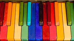 Piano keys painted in bright colours