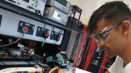 Photo showing student Rishi soldering a circuit board in the Electronics lab in the Diamond.
