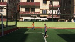 Two boys play football in Beirut